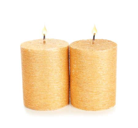 Stylish elegant gold candles on white background. Decor element
