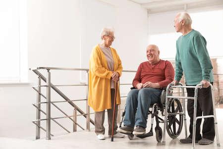 Group of happy senior people in hospital