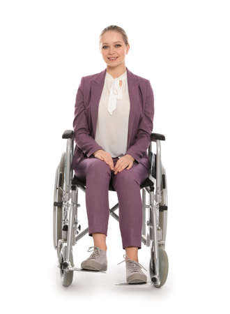 Beautiful young businesswoman in wheelchair isolated on white background Imagens