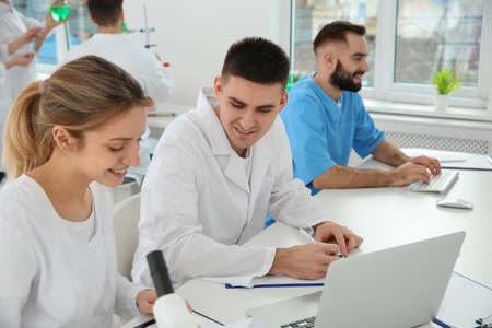 Medical students working in modern scientific laboratory Фото со стока