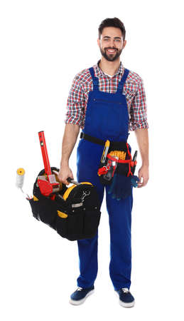 Full length portrait of construction worker with tools on white background