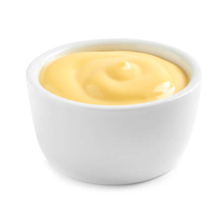 Delicious cheese sauce in bowl on white background Stock Photo