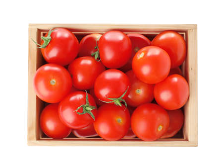 Wooden crate full of fresh ripe tomatoes on white background, top view