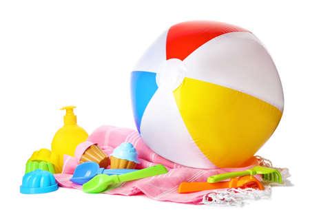 Beach ball and plastic toys on white background Archivio Fotografico