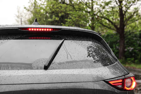 Closeup view of car window on rainy day, closeup