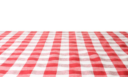 Table with red checkered cloth isolated on white background
