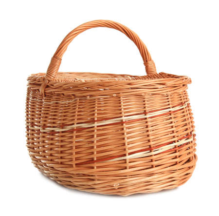 Empty wicker picnic basket isolated on white