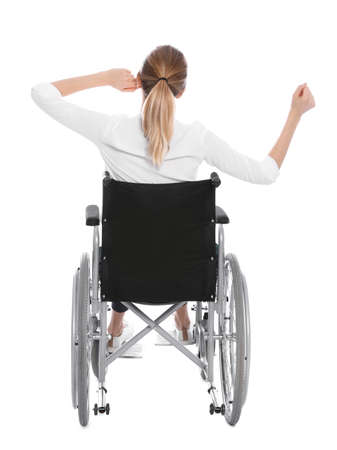 Young woman in wheelchair isolated on white, back view Imagens