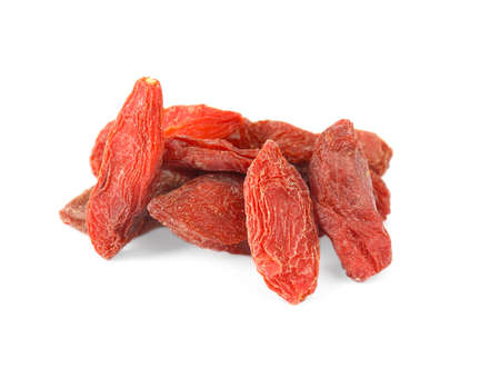Pile of dried goji berries on white background