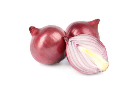 Fresh whole and cut red onions on white background