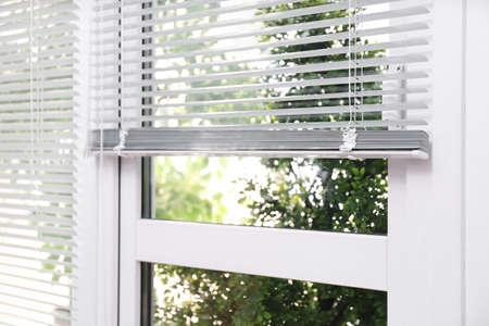 Open white horizontal window blinds, closeup view Imagens - 126664079
