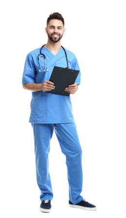Young male doctor in uniform with clipboard isolated on white background
