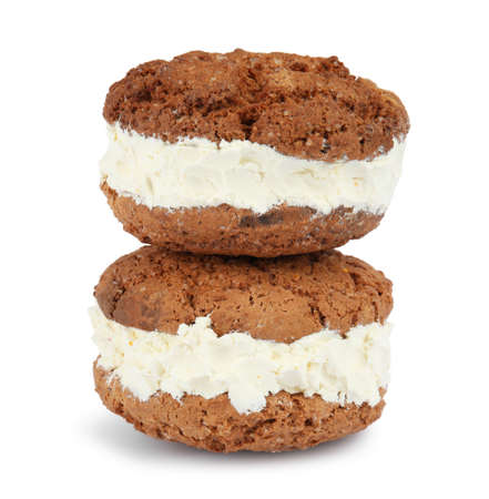 Sweet delicious ice cream cookie sandwiches on white background