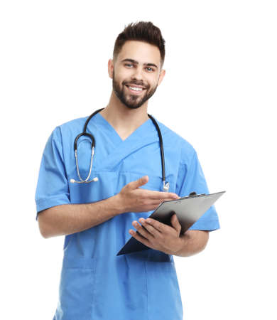 Young male doctor in uniform with clipboard isolated on white