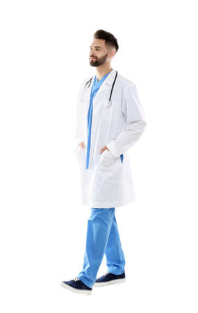 Young male doctor in uniform isolated on white