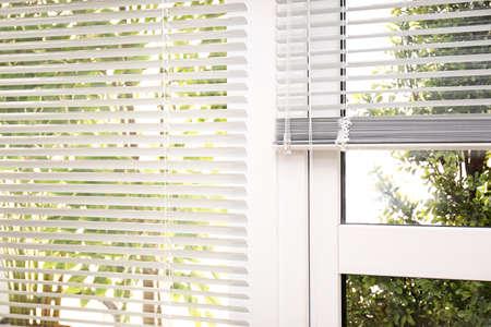 Open white horizontal window blinds, closeup view
