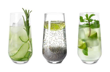 Set glazen met verschillende verfrissende drankjes op witte achtergrond Stockfoto