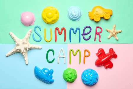 Flat lay composition with text SUMMER CAMP made of modelling clay on color background Stock fotó
