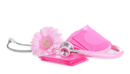 Stethoscope, menstrual pads and flower on white background. Gynecology concept Stock Photo