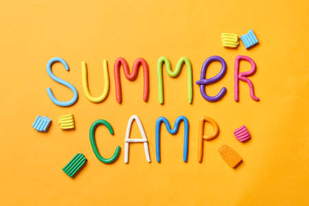 Text SUMMER CAMP made of modelling clay on color background, flat lay Stock fotó