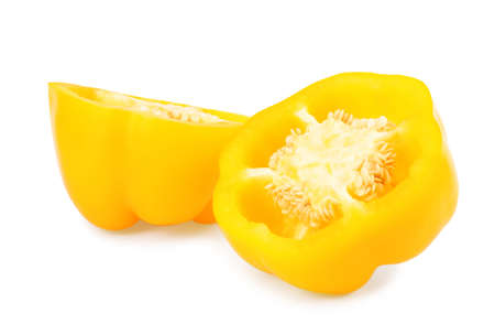 Halves of yellow bell pepper isolated on white