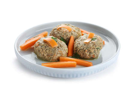 Plate of traditional Passover (Pesach) gefilte fish on white background