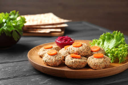 Plate of traditional Passover (Pesach) gefilte fish on wooden table