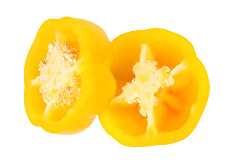 Halves of yellow bell pepper isolated on white, top view