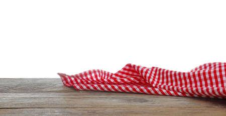 Red checkered cloth on wooden table against white background. Mockup for design Reklamní fotografie