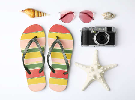 Flat lay composition with different beach objects on white background