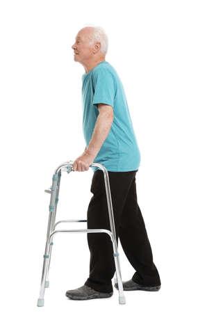 Full length portrait of elderly man using walking frame isolated on white background