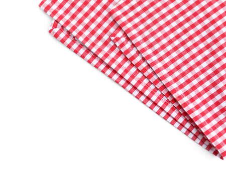 Classica tovaglia a quadretti rossa isolata su bianco, vista dall'alto
