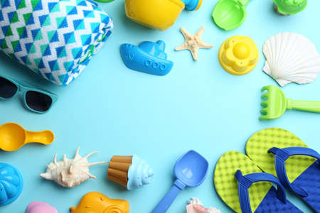 Flat lay composition with bright beach toys on color background. Space for text
