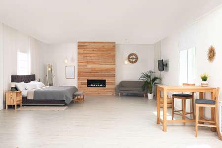 Stylish studio apartment interior with comfortable furniture