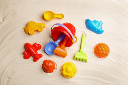Flat lay composition with colorful beach toys on sand Stockfoto - 126795663