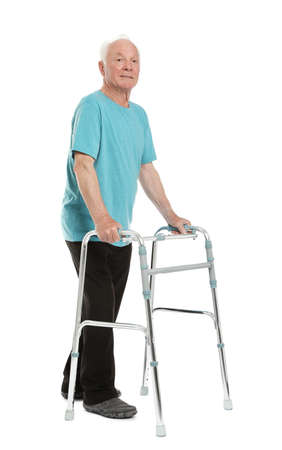 Full length portrait of elderly man using walking frame isolated on white