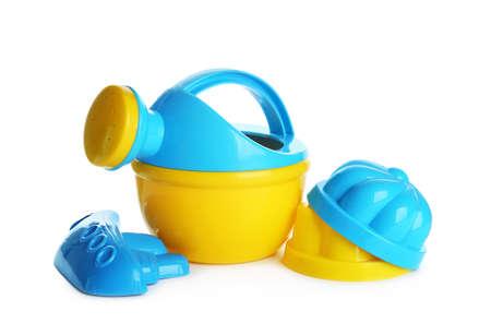 Set of plastic beach toys on white background