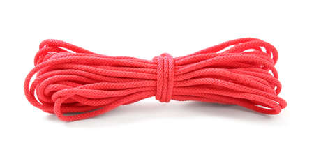 Coil of rope on white background. Camping equipment