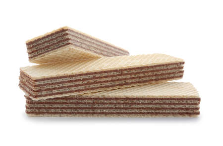 Delicious wafer sticks with chocolate filling isolated on white background