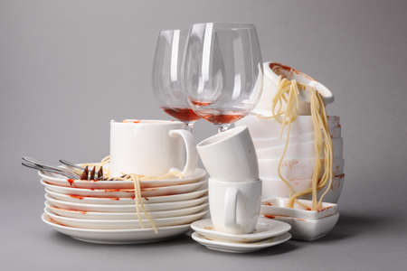 Set of dirty dishes with spaghetti leftovers on grey background Standard-Bild