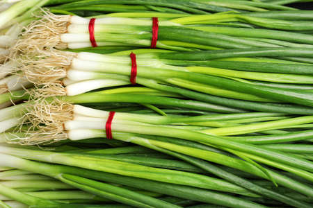 Fresh green onions as background, top view Imagens