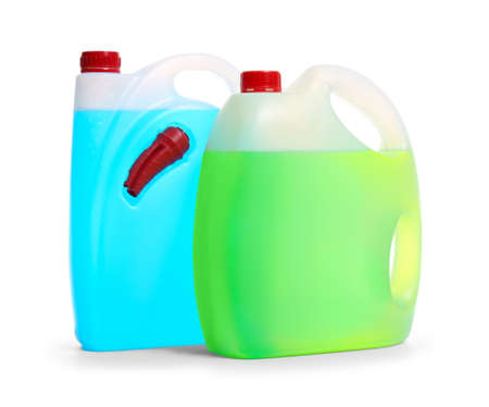 Plastic canisters with different liquids for car on white background Stock Photo