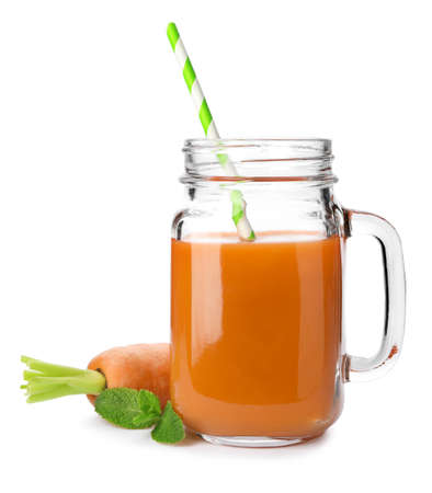 Carrot and mason jar with fresh juice on white background