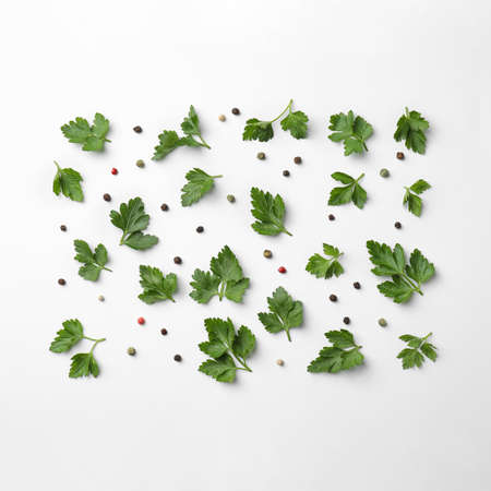 Flat lay composition with green parsley and pepper on white background