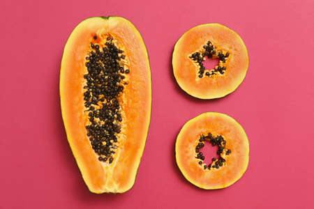 Flat lay composition with cut papaya on pink background 写真素材