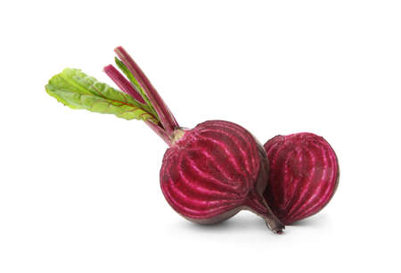 Halves of fresh beet with leaves on white background