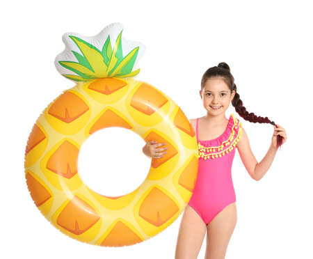 Cute little girl with bright inflatable ring on white background