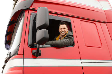 Portrait of happy driver in cab of modern truck 写真素材