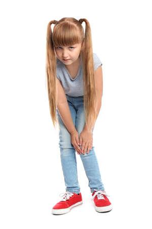 Full length portrait of little girl having knee problems on white background