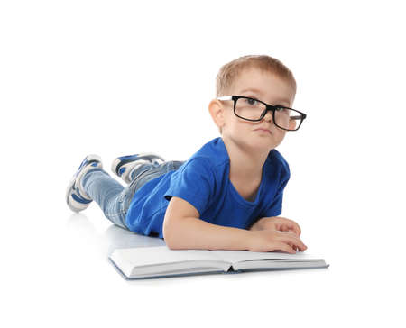 Little child with eyeglasses and book on white background